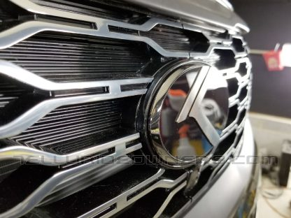 vintage k badge emblem on kia telluride grille