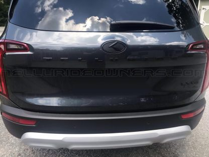 kia telluride with black carbon rear emblem badge hatch
