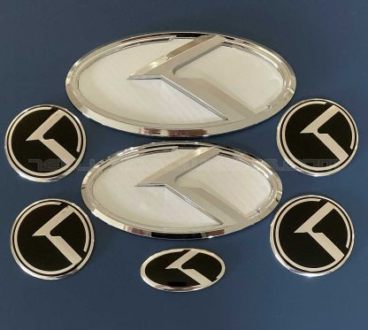white badge emblem for kia telluride with chrome edge and k